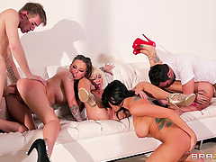 A few stunning bitches get their holes drilled hard in group sex video