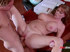 Adorable cougar with big tits in glasses giving huge dick blowjob in the office