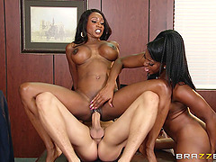 Lusty black chicks make his day at the office with a threesome