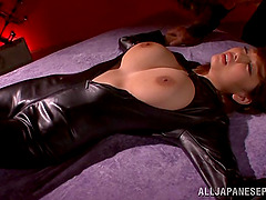 Busty Japanese slut in latex riding a pulsating cock