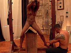 Gorgeous ebony babe tied up and played with in a bdsm orgy scene.