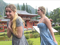 Lesbian couple kissing and flashing at a Japanese temple