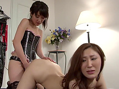 Two horny lesbian Asian babes riding a fuck machine