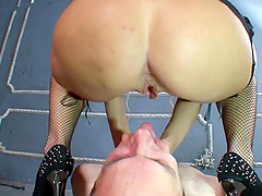 Dominant blonde with huge buttocks sits down on her slave's head