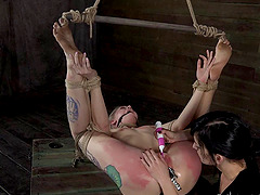 Rope bound and ball gagged girl licked by mistress