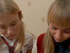 Pair of fascinating schoolgirls and their wicked session on the couch