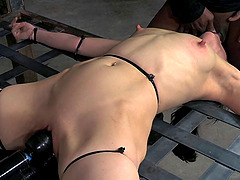 Bondage brunette getting nasty facial cumshot in BDSM