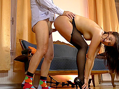 Schoolgirl wearing stockings sits down on the rock-solid mature cock