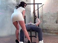 Cindy Dollar knows how to make her slave's cock hard with her hands