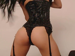 Sexy bunny babe in a hot short corset plays with her dildo