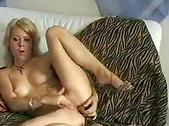 Amateur blonde college girl first time penetrates herself with her new dildo and tapes it for her boyfriend abroad