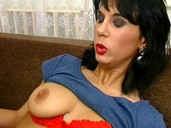 Brunette mom sensually caressing her boobs and pussy warming things up.