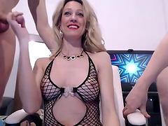 Busty blonde camgirl plays with two cocks in front of the webcam