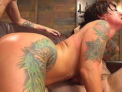 Tattooed brunette MILF gets tied up and fucked with double penetration