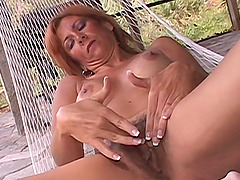 This busty redhead mature is a total sex fiend!