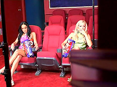 Esmerelda and Sophie Moone have lesbian fun in a cinema. Backstage clip