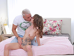 Cute girl Stasia Si with a tattoo and glasses loves to eat cum