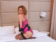 Kinky mature amateur Dafrna May spreads her legs to flash her pussy