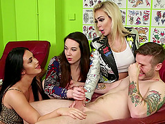 Tattooed dude undressed and pleasured by 3 CFNM pornstars