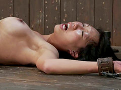 Tia Ling moans loudly while getting her Asian cunt fingered in BDSM scene