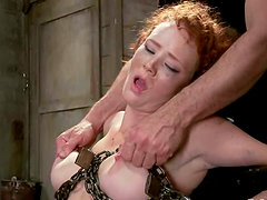 Redhead Audrey Hollander gets chained and face fucked